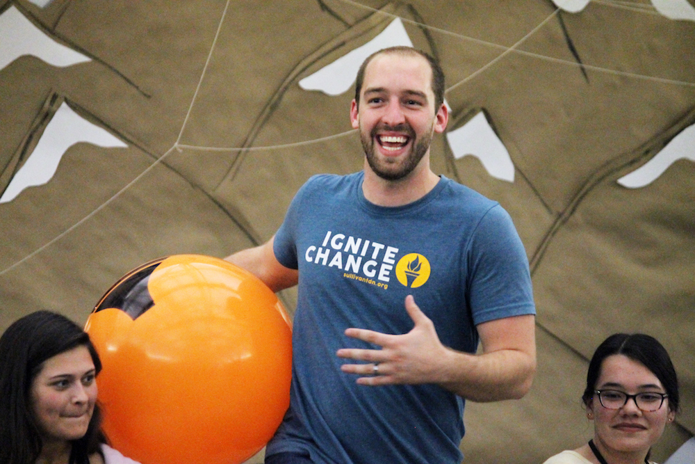 this photo shows the fun energy that Chad Littlefield brings to his Ignite Retreat presentations