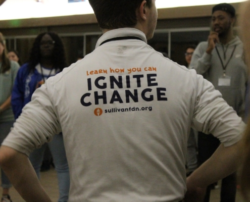 this photo reinforces the Ignite Retreat message through a logoed t-shirt