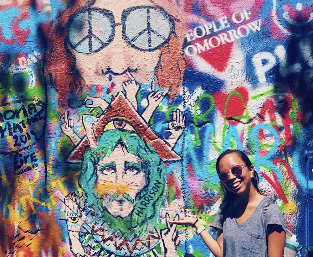 this photo shows the subject's excitement to visit the John Lennon Wall in Prague