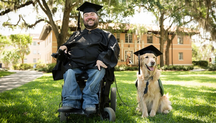 this photo shows a service dog with an owner who has a disability