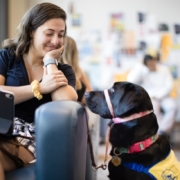 This photo shows Marissa Cobuzio with the service dog she trained for Canine Companions for Independence