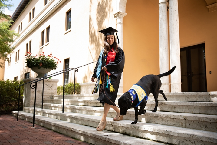 this photo shows the close relationship between Marissa Cobuzio and her service dog