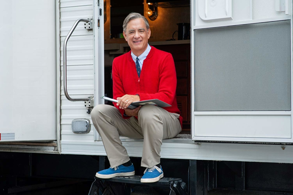 this photo shows Tom Hanks in the role of the real Mister Rogers