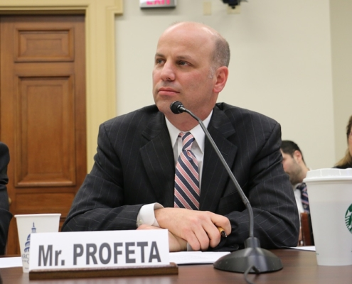 this photo shows Tim Profeta speaking to Congress about reducing carbon emissions in the U.S.