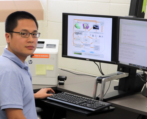 this photo shows Di Tian, an Auburn scientist focused on water-use efficiency
