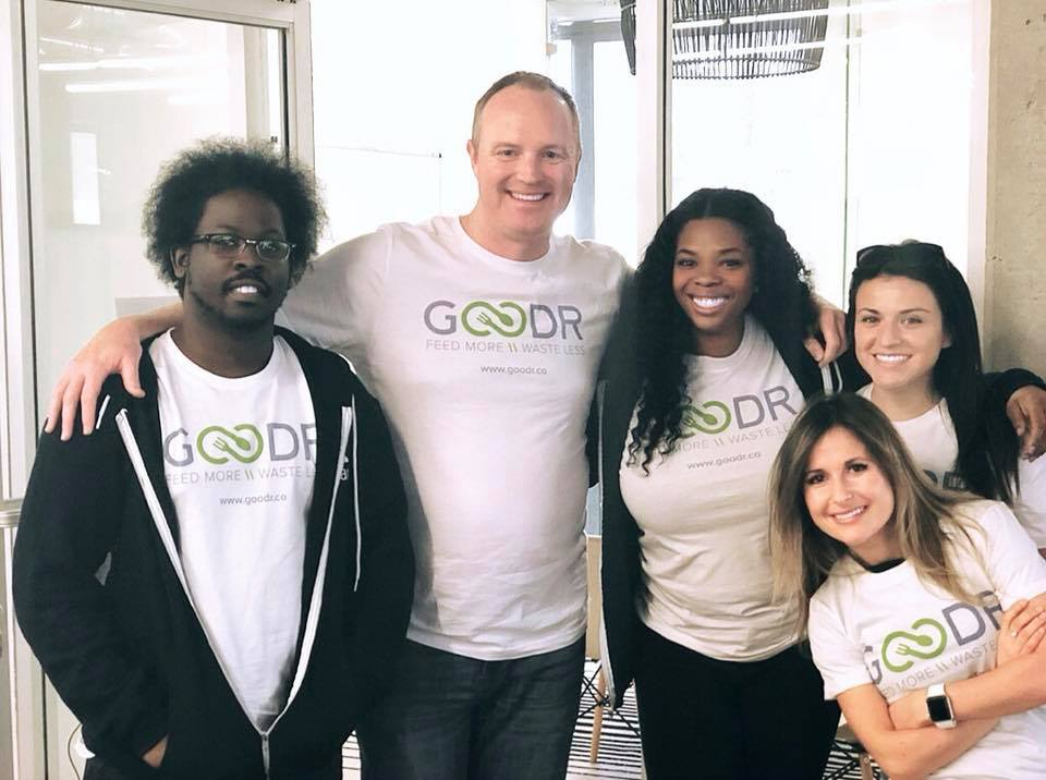 this photo depicts Jasmine Crowe and her Goodr team that works to feed the hungry and reduce food waste