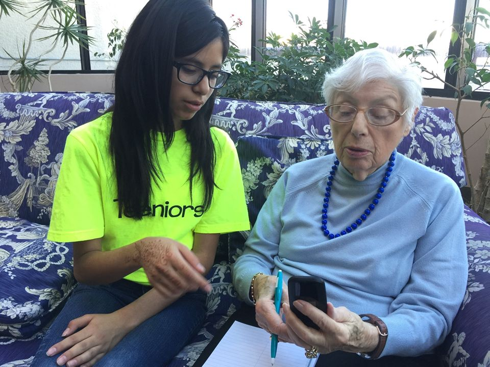 this photo shows a Teeniors teen with an elderly client