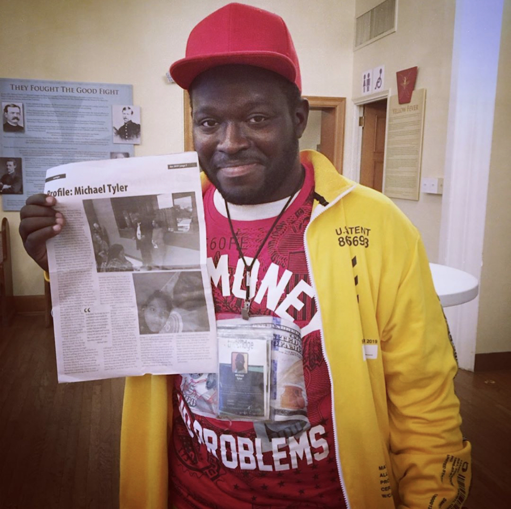 this photo shows a street newspaper vendor named Michael Tyler