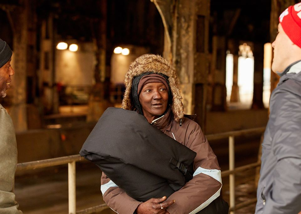this photo shows a homeless woman with a coat from Empowerment Plan