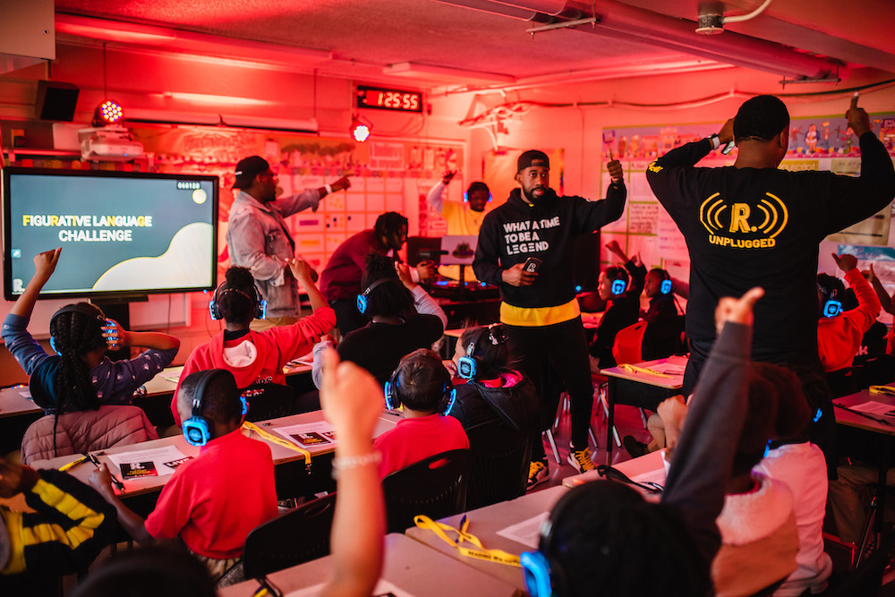 this is a photo of a Reading With a Rapper class in action
