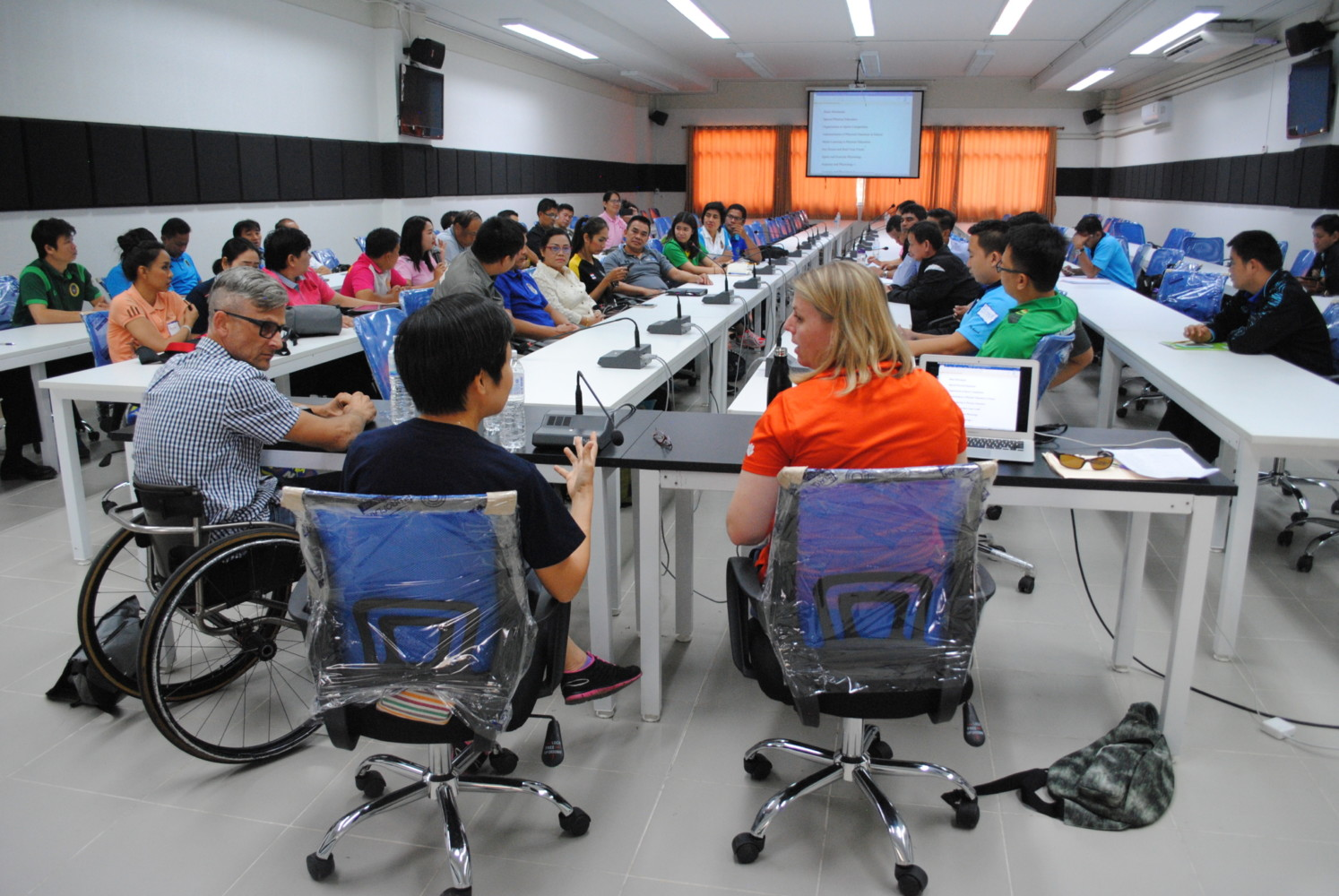 this photo shows Jasmine Townsend of Clemson University addressing members of the Thai Paralympics Committee on inclusion in recreation
