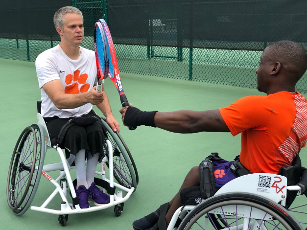 this photo shows wheelchair tennis athletes in Clemson University's first adaptive sports team