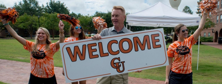 photo of group welcoming new students to Campbell University, which now provides free rooms to all students due to the coronavirus pandemic