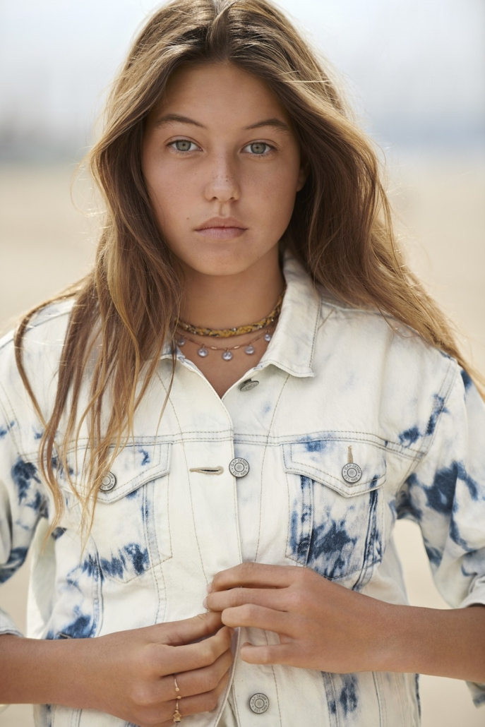 a photo of a young woman modeling sustainable fashion from the Gap Teen line