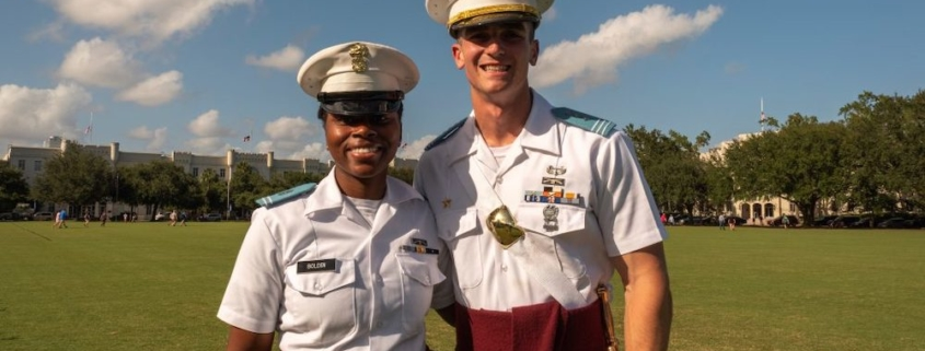 """this photo shows Richard """"Ben"""" Snyder of The Citadel with fellow cadet Ruby Bolden in their dress uniforms"""