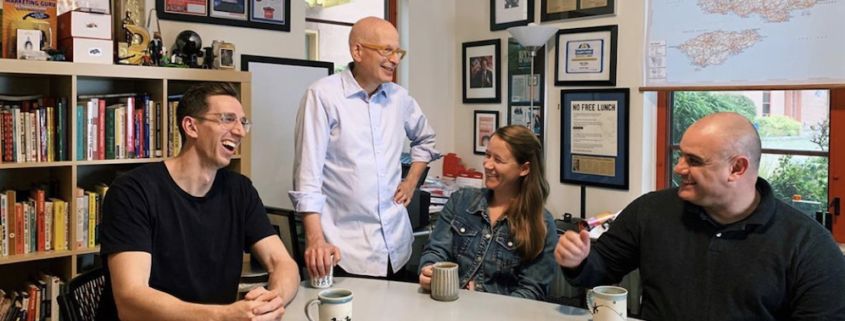 Seth Grodin, founder of Akimbo, is shown in an office with members of his altMBA team