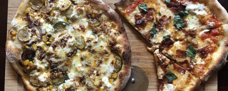this photo shows two pizzas made by Stephen Turselli, founder of the Social Justice Pizza Project in Pittsburgh