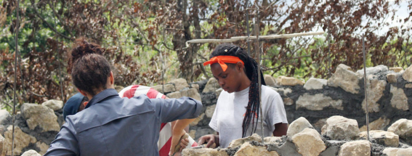 this photo shows a Mercer University student assisting with construction of a stone masonry water tank in the Dominican Republic.