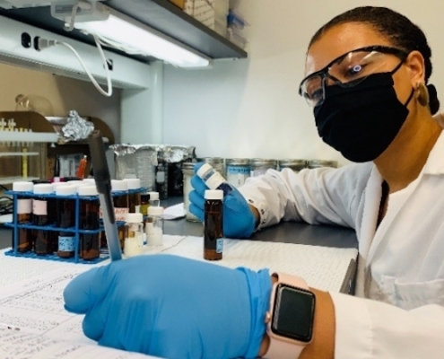 this photo shows Imari Walker Karega conducting research on microplastics in a laboratory at Duke University