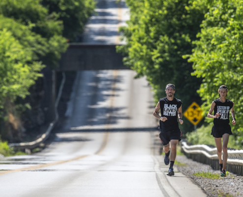 this photo shows Josh Nadzam and Gavin Galanes running in the Run for Black Lives fundraiser in Kentucky.