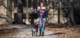 Lauren Graham is pictured walking her emotional support dog, a black Labradore retriever, on the University of Mississippi campus