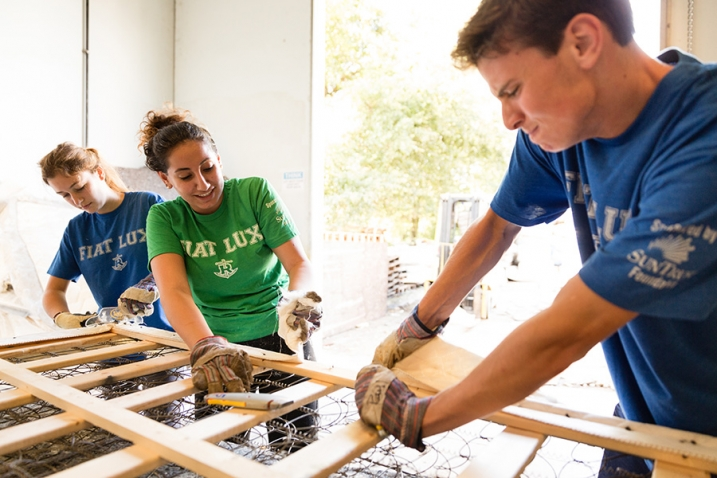 Rollins College students are shown building a mattress on SPARC Day