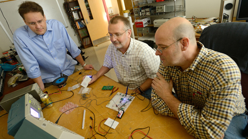 this photo shows University of Mississippi scientists who developed a prosthetic device to help people overcome their stutters