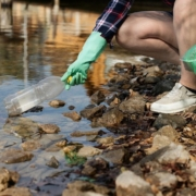 this photo shows a plastic bottle being retrieved from a river in California