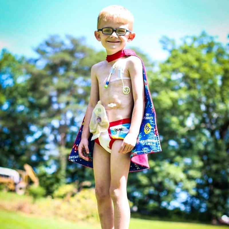 this photo shows Gunner Bowlin, the inspiration for Gutsy Gunner's Sweet Dreams, in a superhero costume.