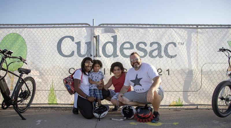 this photo shows a family that will be living in the car-free community of Culdesac Tempe in Tempe, Arizona.