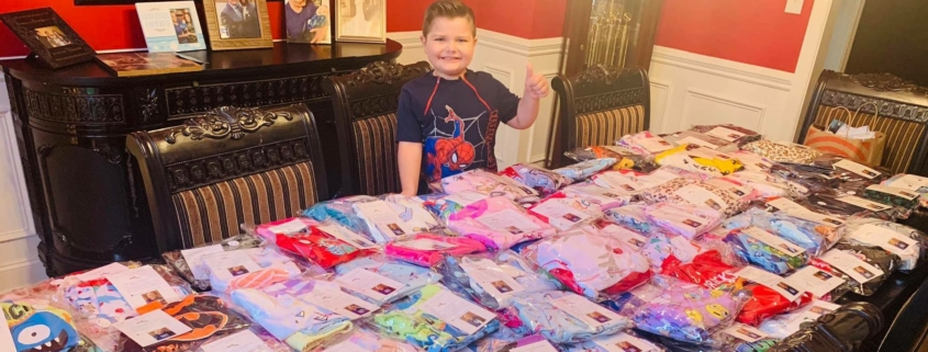 this photo shows Noah Sileno with medically adapted pajamas donated by the #NoahNation Foundation to kids with cancer