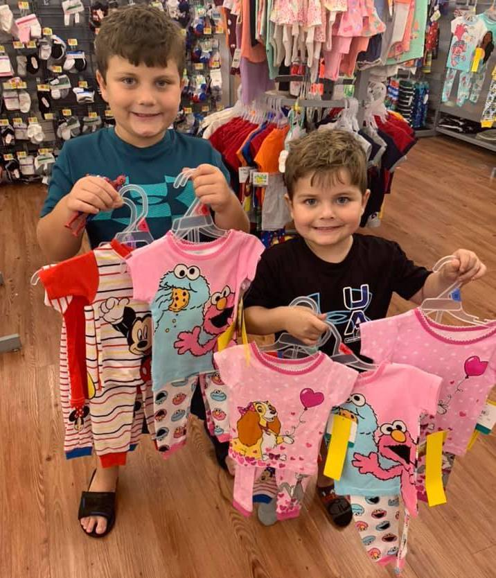 this photo shows two little boys with medically adapted pajamas from the #NoahNation Foundation