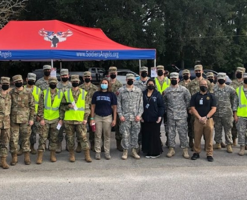 this photo shows volunteers from The Citadel as they provide food for low-income veterans as part of the Soldiers' Angels project.
