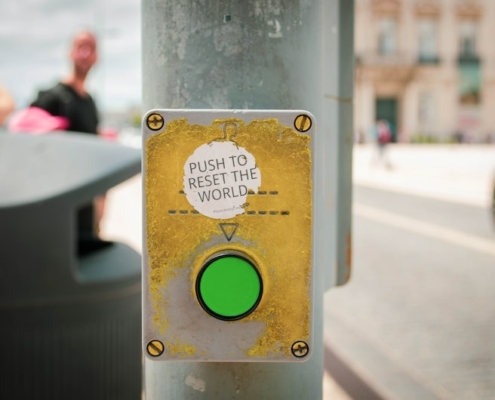 this photo of a green button illustrates the concept of the Great Reset of the world economy