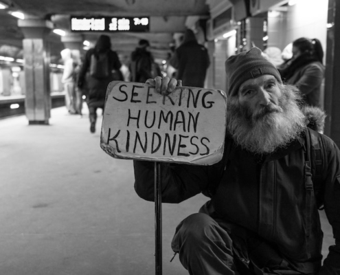 this photo shows a homeless man in a Boston subway and illustrates the New Leaf Project point that homeless people will spend money wisely if they have it.