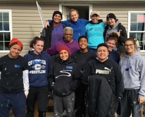 this photo shows the members of the women's wrestling team working on a Ferrum College service project for Habitat for Humanity