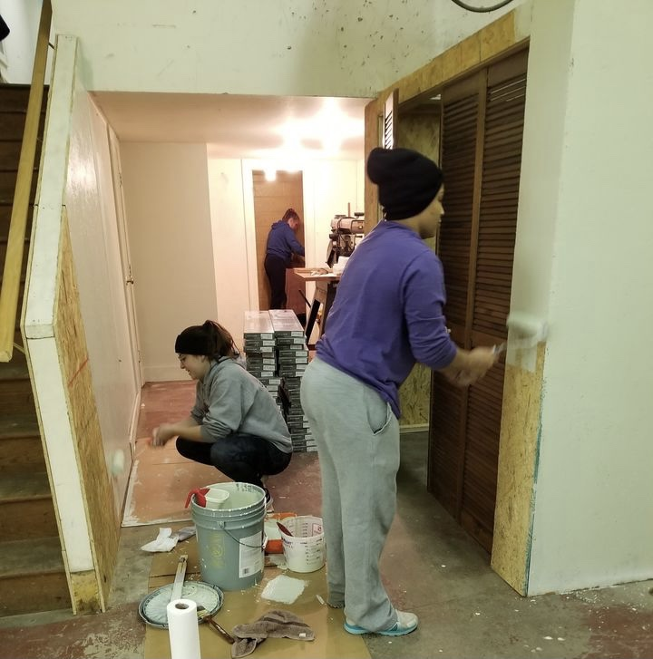this photo shows Ferrum College students and staff members working on a service project for Habitat for Humanity in Rocky Mount, Virginia