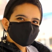 this photo shows Lexi Tavakoli, a student in Mary Baldwin University's Program for the Exceptionally Gifted, wearing her mask while volunteering for the Out of the Darkness Walk
