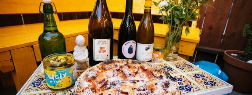 this photo shows a pizza made with food waste ingredients from Shuggie's Trash Pies and Natural Wine, a sustainable restaurant opening this spring in San Francisco