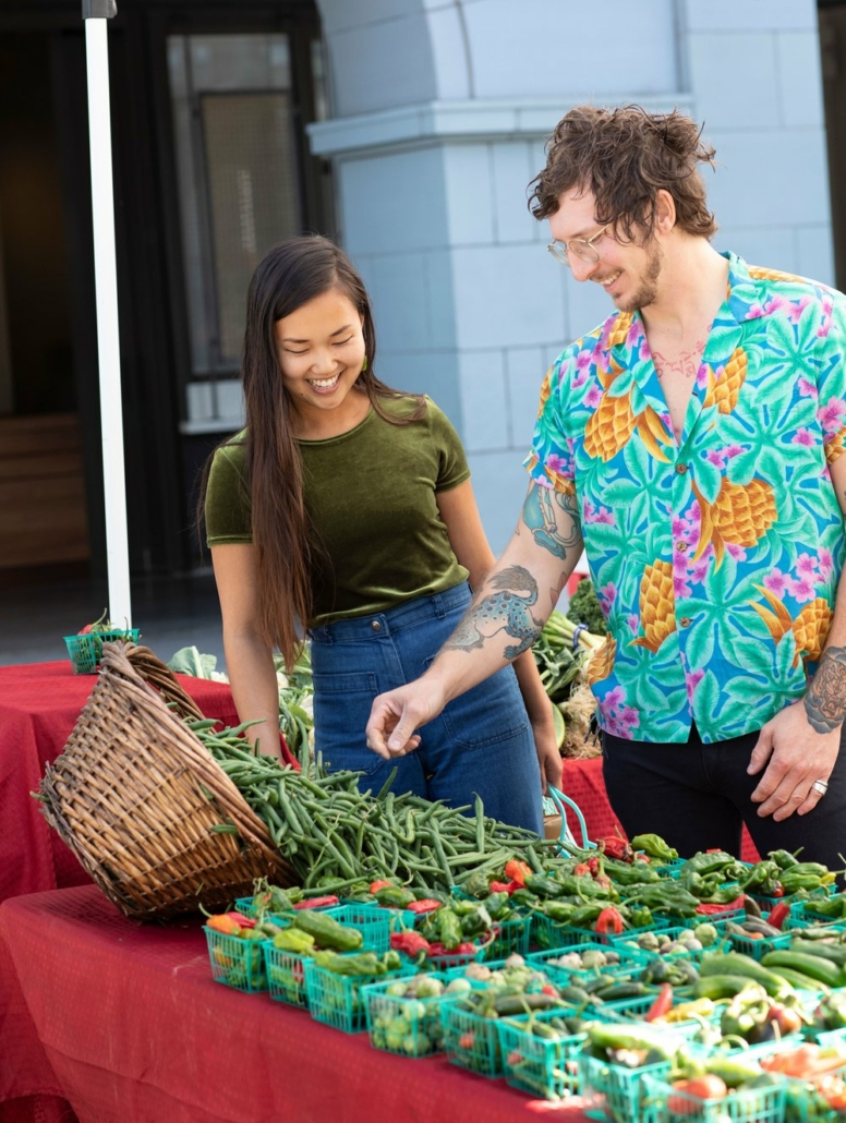 this photo shows Kayla Abe and David Murphy, founders of a sustainable restaurant using food waste as its main ingredients