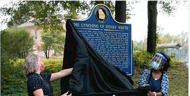 this is a photo of two women unveiling the Henry White Memorial marker in Lafayette, Georgia