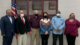 this photo shows Holly Barnett, a University of Alabama graduate student and member of the West Blocton, Alabama City Council, posing with other council members and the mayor