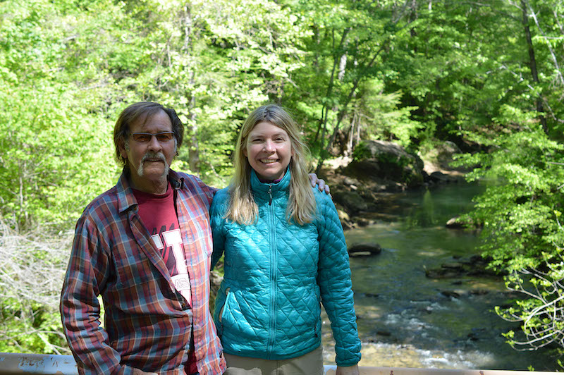 this photo depicts Leigh Mayberry, an Alabama nurse, on a hike with her father, Rick, in the Sipsey Wilderness