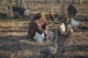 This photo shows Sarah Barwick feeding chickens at Feel Better Farm in Greene County Virginia