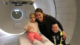 this photo shows Teagan Fettig, a little girl with cancer, at an MRI machine with her mother Tatum Fettig, who co-created the Community Heals app