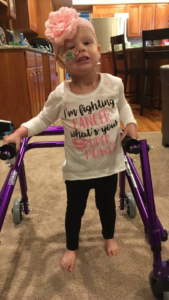 this is the photo of little Teagan Fettig, a six-year-old cancer survivor, using her walker to get around