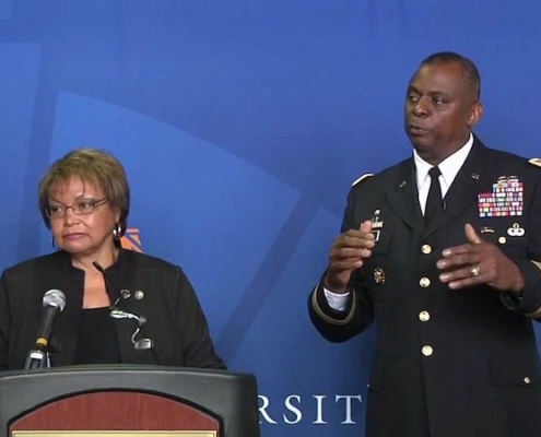 this is a photo of Auburn University alumnus General Lloyd Austin, the first black secretary of defense, with his wife Charlene speaking at an Auburn event