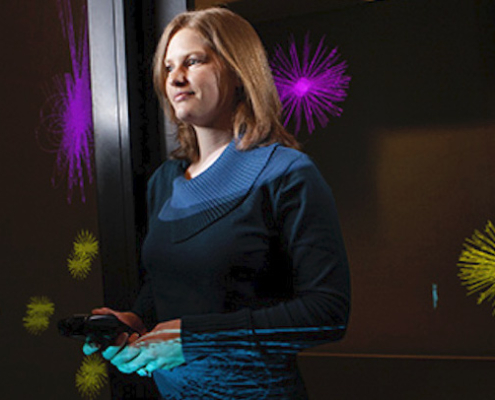 this photo shows Tabitha Peck of Davidson College in a virtual reality environment at Duke University