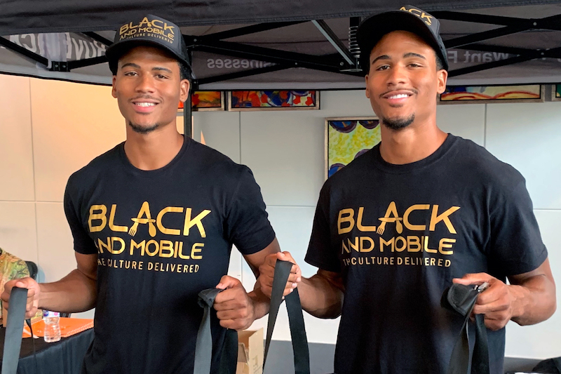this photo shows David and Aaron Cabello, founders of Black and Mobile, a third-party food delivery company that supports black-owned restaurants