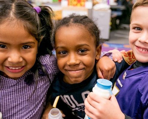 this is a photo of a group of cute kids who benefit from No Kid Hungry's campaign to combat food insecurity